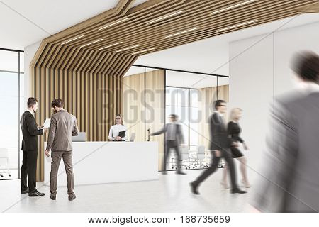 People in room with reception counter with two laptops. Meeting room with glass walls behind it. Brown pipes are lowering from the ceiling. 3d rendering. Mock up.