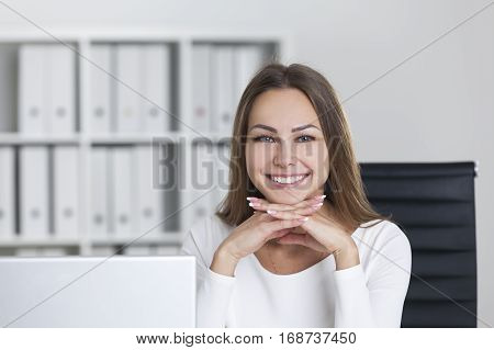 Cheerful Woman With Hands Under Chin
