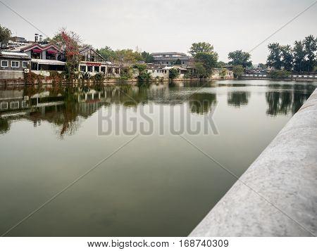 Beijing, China - Oct 30, 2016: View of the Tongzi He (Pipe River); a moat surrounding the Forbidden City (Gu Gong, Palace Museum). Along Donghuamen Road.