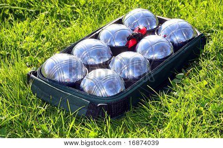 Bocce balls on a green grass.