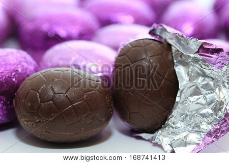 colorful wrapped chocolate easter eggs in close-up macro