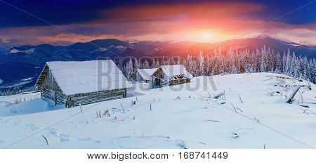 cabins in the mountains in winter, majestic snowy landscape