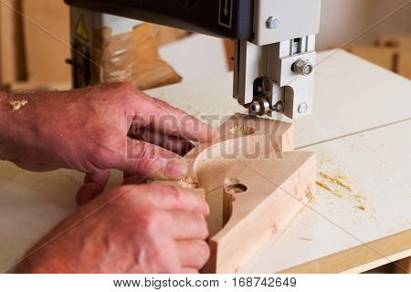 Carpenter tools on wooden table with sawdust. Circular Saw. Carpenter workplace top view.