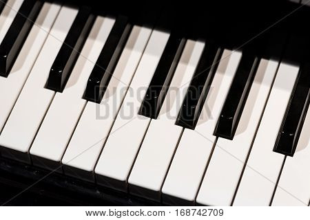 Close view on the piano's b-w keyboard