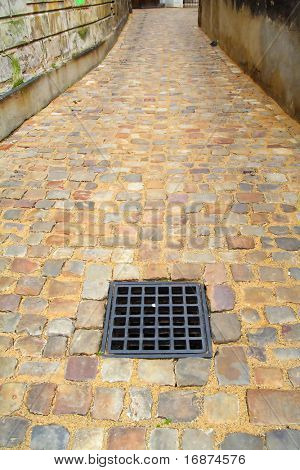 Gully on old town street. Prague city - Czech Republic - Europe