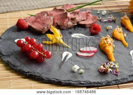slices of duck fried meat in fancy food arrangement