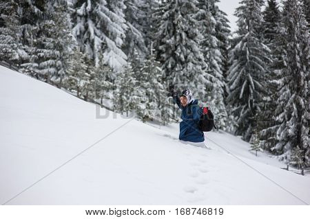 Photographer tourist in winter mountains, beautiful landscape