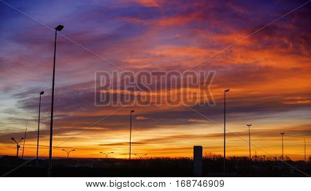 Colorful sunset over the mountain hills, majestic sky