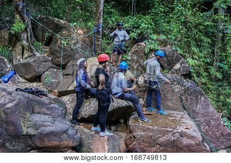 Beaufort,Sabah,Malaysia-Jan 28,2017:Group of canyoneer get ready to abseil down a waterfall in Beaufort,Sabah,Borneo.Waterfall Abseiling activity adventure getting famous in Sabah,Malaysia.