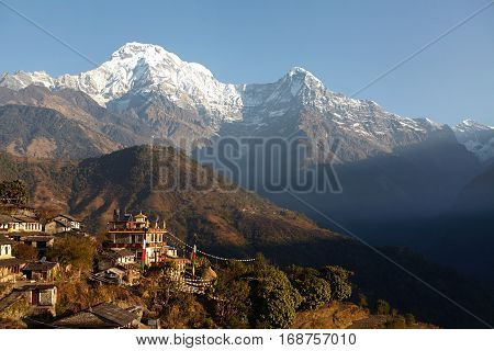 Amazing Landscape Of Gorgeous Gigantic Mountains And Cliffs Of The Himalayas Standing High Above Vil