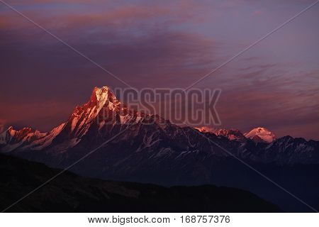 Calm And Peaceful Scenic View Of Double Summit Of Machapuchare Resembling Fishtail Rising Over Valle