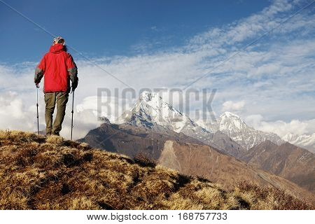 Travel, Adventure, Hiking, Extreme And People. Rear View Of Trekker In Red Vest Standing On Cliff's