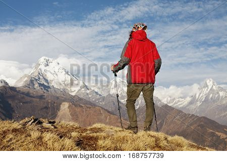 Mountaineering, Climbing And Hiking Concept. Unrecognizable Tourist Holding Trekking Poles Having Re