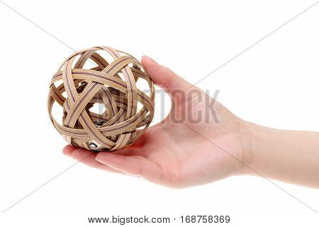 Hand holding asian traditional ball isolated on white background