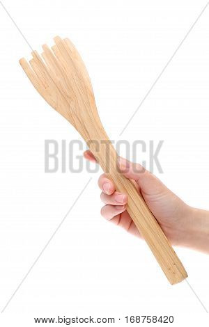 hand holding wooden kitchen tongs isolated on a white background
