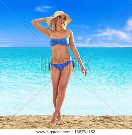 Feeling the sun at beautiful beach. sunbathing fitness woman.