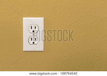 Electrical Sockets In Colorful Mustard Yellow Wall of House.