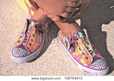 A Young Girl's Colorful, Funky jazzy Sneakers