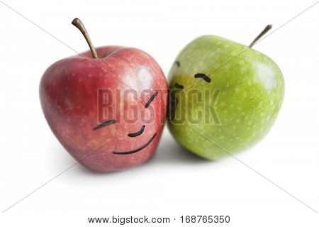 Granny smith apple kissing red apple over white background