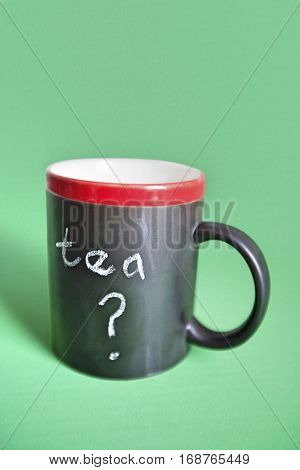 Close-up of coffee mug with text over colored background