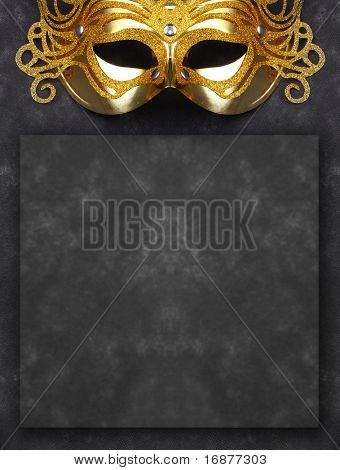 Decorated mask for masquerade on dark background with room for your text. Great for halloween brochures and advertisements. Unauthorized homemade paper product.