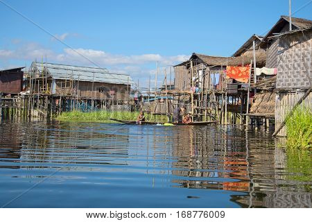 INLE LAKE, MYANMAR - DECEMBER 26, 2016: Burmese women bathe in the lake near his home on the lake. A fishing village on the Inle lake