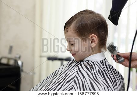Serious Kid Getting Haircut