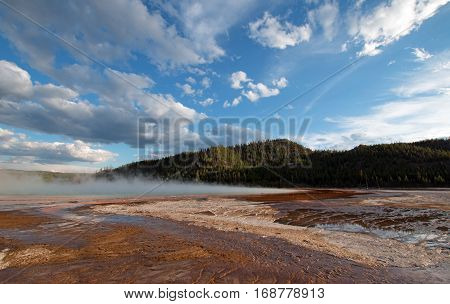 Grand Prismatic Hot Spring under clouds - Yellowstone National Park in Wyoming USA