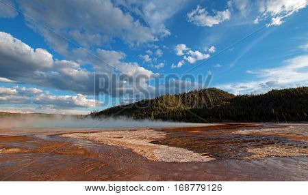 Grand Prismatic Hot Spring under western cloudscape in the Midway Geyser Basin in Yellowstone National Park in Wyoming U S