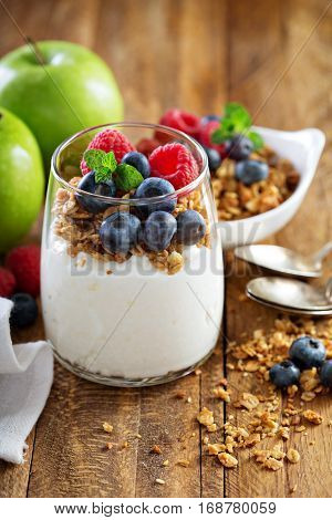 Cottage cheese and yogurt parfait with granola and fresh berry