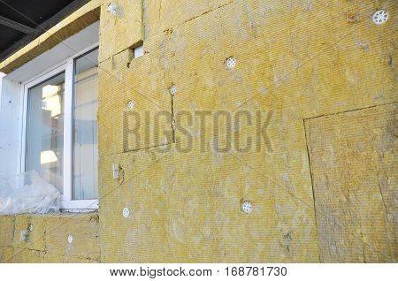 Windows Area External Wall Insulation with Fiberglass.
