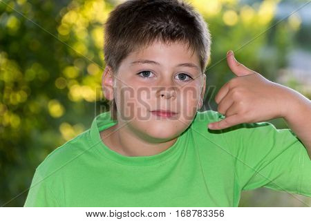 Boy shows gesture talking on the phone