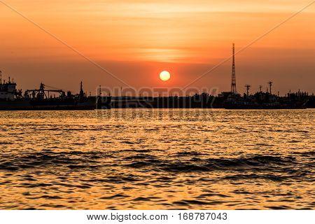 Sunset in Arkhangelsk view from the opposite bank of the samutprakarn, thailand