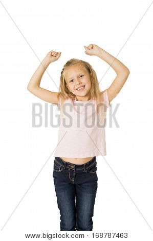 young beautiful and happy female child gesturing excited and smiling cheerful rising arms isolated on white background in school girl success and self confidence