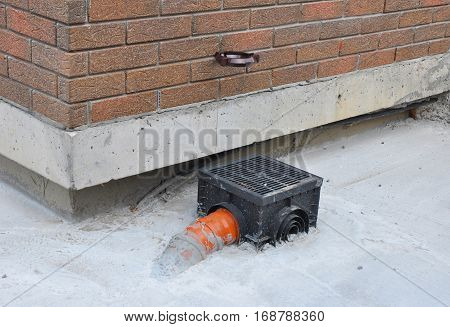 Rain gutter with new installed underground drainage system. Rain gutter system on your house is designed to catch and remove water from the roof and the down spouts. poster