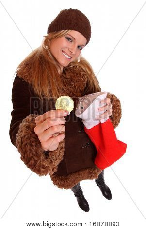 Smiling young woman with luxury christmas gift - golden money. Great for bank's advertising brochures and leaflets.
