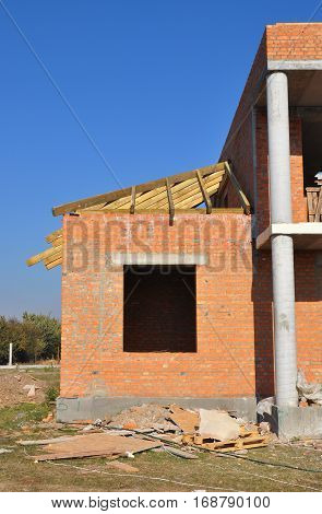 New brick building house construction with doorway columns windows with roofing frame construction
