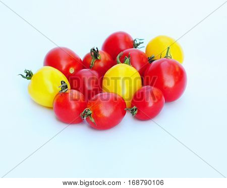 Red and Yellow group of Tomatoes Cherry Isolated on Blue Background