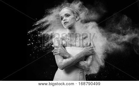 Art Portrait Of A Beautiful Woman Covered In White Dust