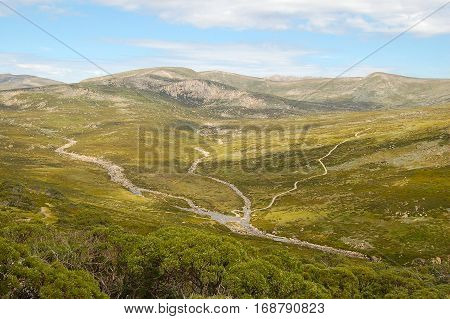 A walking track crosses the creeks below the Charlotte Pass of the Snowy Mountains in New South Wales, Australia