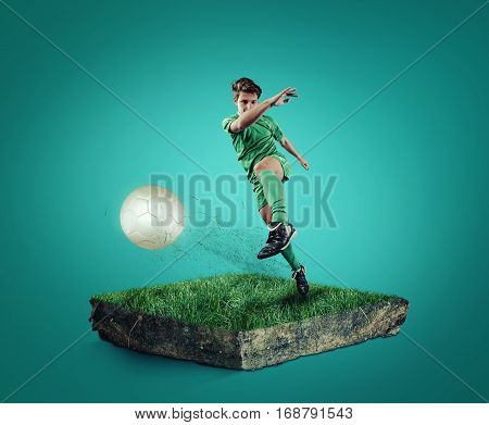 Teen playing soccer on a cube of grass.