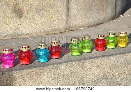 Funeral candles on the stone stairs. Funeral candles