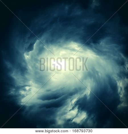 Toned Photo of Blurred Swirl in the Dark Storm Clouds with Flash of the Light