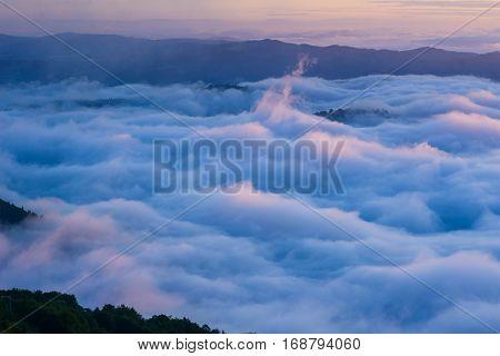Cumulus fantastic fog in the morning sky. Carpathian, Ukraine, Europe