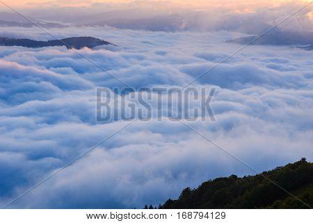 Cumulus fantastic fog in the morning sky.Carpathian, Ukraine, Europe