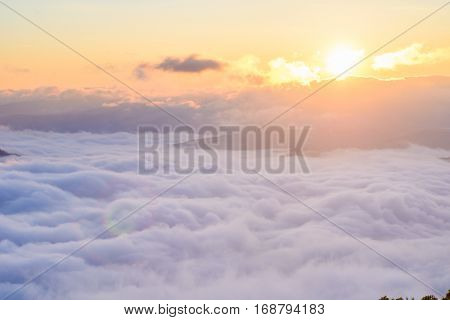 Sunrise in the mountains in the mist cumulus