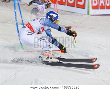 STOCKHOLM SWEDEN - JAN 31 2017: Side view of Linus Strasser (GER) and competitor in the parallel slalom downhill alpine skiing event Audi FIS Ski World Cup. January 31 2017 Stockholm Sweden