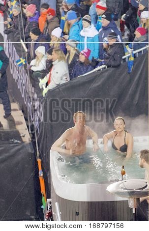 STOCKHOLM SWEDEN - JAN 31 2017: VIP audience in a bath tub at the parallel slalom event at the Alpine Audi FIS Ski World Cup - city event January 31 2017 Stockholm Sweden