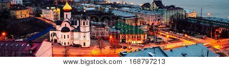 Nizhny Novgorod Russia. Aerial view of illuminated historical buildings at night with river in Nizhny Novgorod Russia