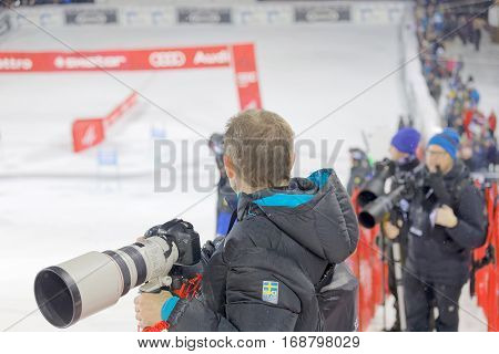 STOCKHOLM SWEDEN - JAN 31 2017: Press photographers with tele lenses covering the parallel slalom event at the Alpine Audi FIS Ski World Cup - city event January 31 2017 Stockholm Sweden